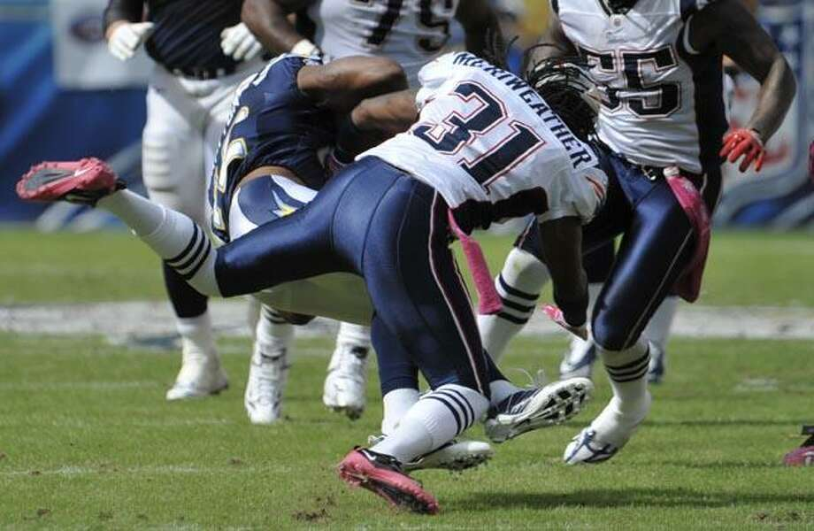 New England Patriots safety Brandon Meriweather hits San Diego Chargers wide receiver Patrick Crayton during the first half of an NFL football game Sunday in San Diego. (AP Photo/Denis Poroy) Photo: AP / FR59680 AP