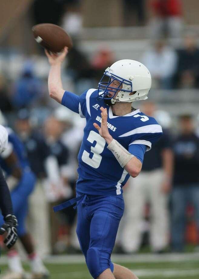 SCOTT CARICATO/Submitted photo Hall quarterback Zach Dobbins gets ready to throw a pass during Saturday's game against Middletown. Hall handed Middletown its first loss of the season, 36-26.