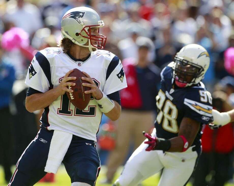 New England Patriots quarterback Tom Brady looks to pass against the San Diego Chargers in the first half during an NFL football game Sunday in San Diego. (AP Photo/Lenny Ignelzi) Photo: AP / AP