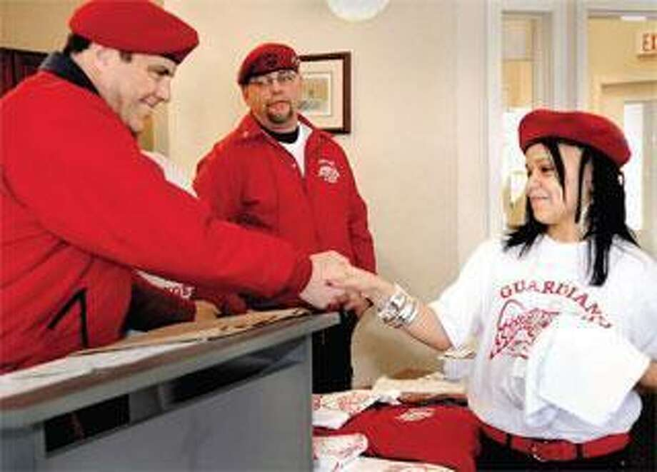 In this file photo, Curtis Sliwa, founder of the Guardian Angels, congratulates Melissa Morales as she is inducted into the group during a ceremony in New Haven. (Melanie Stengel/Register)