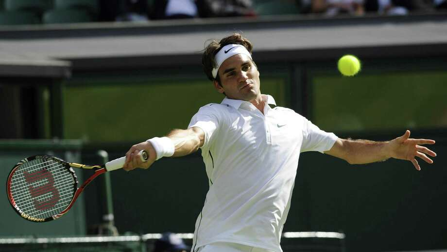 Tennis - 2011 Wimbledon Championships - Day Two - The All England Lawn Tennis and Croquet Club. Switzerland's Roger Federer in action against Kazakhstan's Mikhail Kukushkin during day two of the 2011 Wimbledon Championships at the All England Lawn Tennis and Croquet Club, Wimbledon. Picture date: Tuesday June 21, 2011. Photo credit should read: Rebecca Naden/PA Wire. URN:11016809 (Press Association via AP Images) Photo: Associated Press / PA Wire/Press Association Images2011