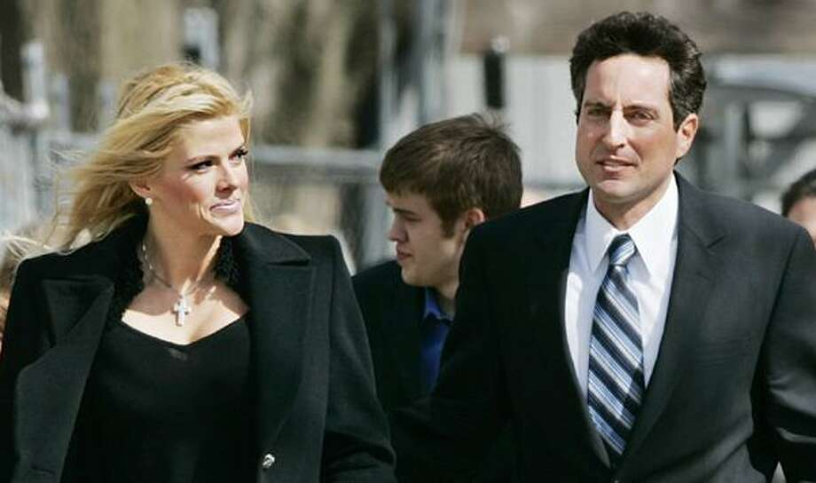 "In this Feb. 28, 2006, file photo, Anna Nicole Smith, left, her son Daniel Smith, center, and her lawyer, Howard K. Stern leave the U.S. Supreme Court in Washington. The judge brought to fame in the fight over Anna Nicole Smith's remains says he believes someone is guilty of manslaughter in the starlet's death and second-guesses his own decision over where she is buried in a book to be released Tuesday. Larry Seidlin, the former Fort Lauderdale judge, is harshly critical of Smith's lawyer-turned-companion Howard K. Stern, and of the police investigations into the death of the Playboy Playmate and her son. But as provocatively titled as ""The Killing of Anna Nicole Smith"" is, Seidlin offers no actual evidence either death was anything more than the accidental drug overdoses they were deemed.  (AP) Photo: AP / AP2006"