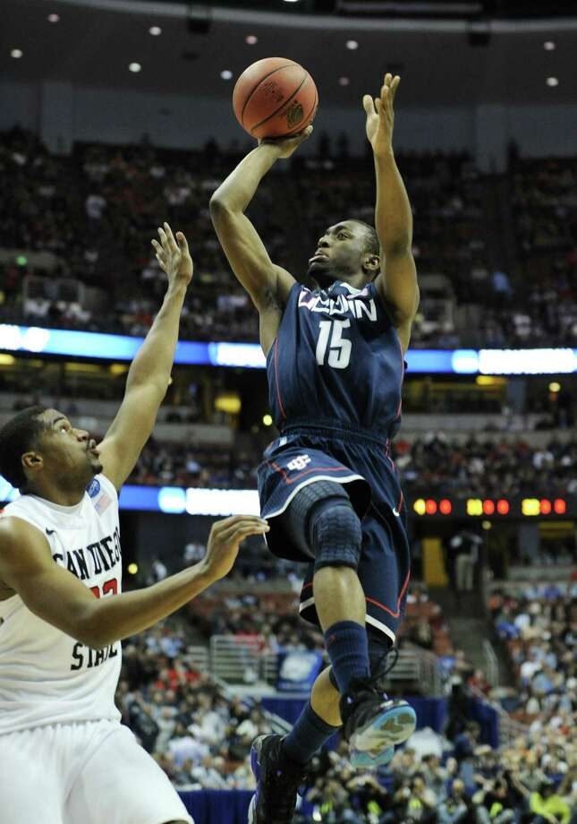 FILE - This March 24, 2011 file photo shows Connecticut's Kemba Walker (15) shooting over San Diego State's Chase Tapley (22) during the first half of a West regional semifinal game in the NCAA college basketball tournament, in Anaheim, Calif. Walker is a top prospect in the 2011 draft.  (AP Photo/Mark J. Terrill, File) Photo: ASSOCIATED PRESS / AP2011