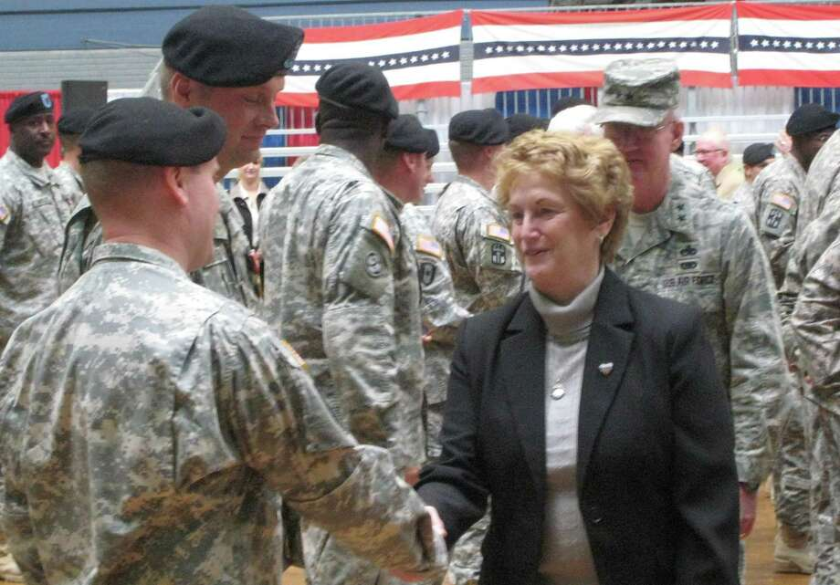Gov. Rell and Connecticut National Guard Adjutant General Thaddeus Martin (right) commend soldiers on a job well done.
