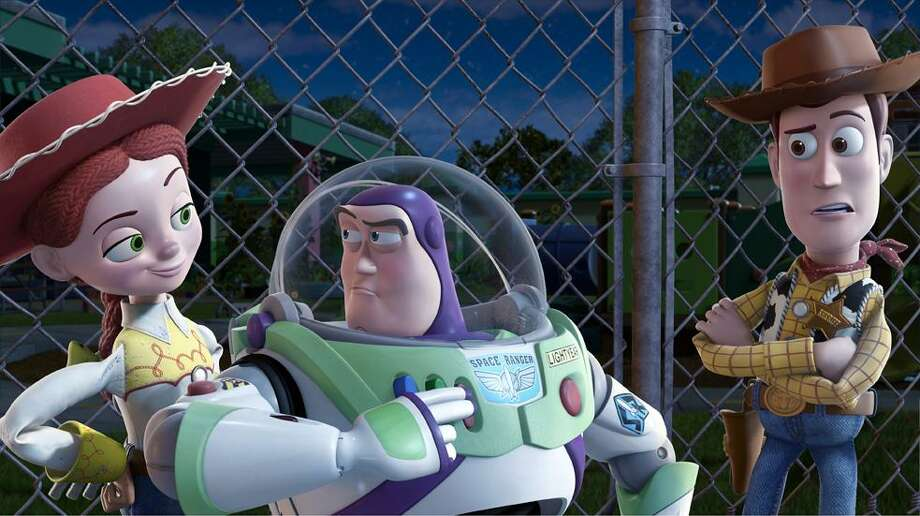 "In this film publicity image released by Disney, from left, Jessie, voiced by Joan Cusack, Buzz Lightyear, voiced by Tim Allen and Woody, voiced by Tom Hanks are shown in a scene from ""Toy Story 3."" (AP) Photo: AP / ©Disney/Pixar.  All Rights Reserved."