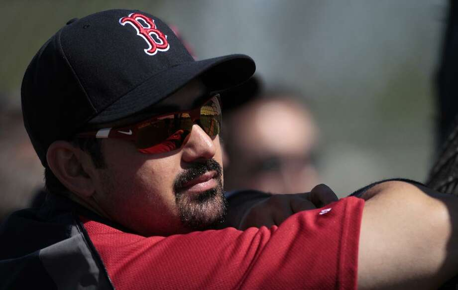 it was the first day of spring training baseball for the full Red Sox squad at the Player Development Complex in Fort Myers, Fla., Saturday, Feb. 19, 2011. (AP Photo/Dave Martin)