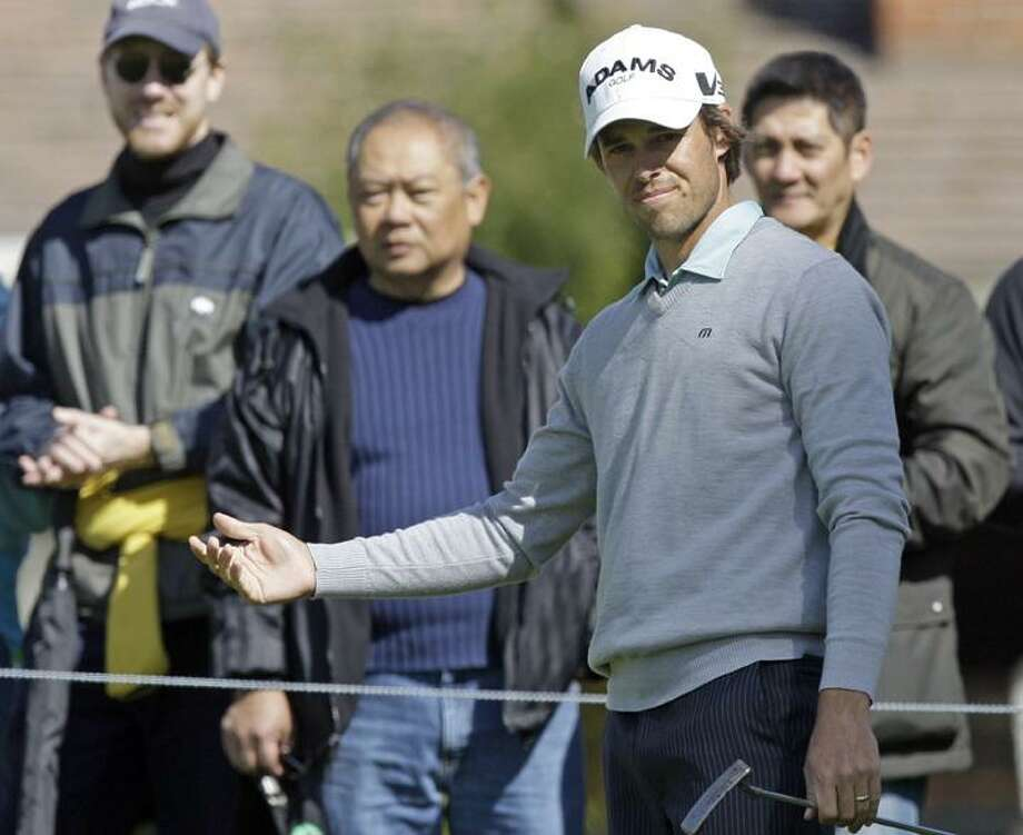Aaron Baddeley, of Australia, gestures after putting on the first green in the third round of the Northern Trust Open PGA golf tournament at Riviera Country Club in the Pacific Palisades area of Los Angeles Saturday, Feb. 19, 2011.  (AP Photo/Reed Saxon)