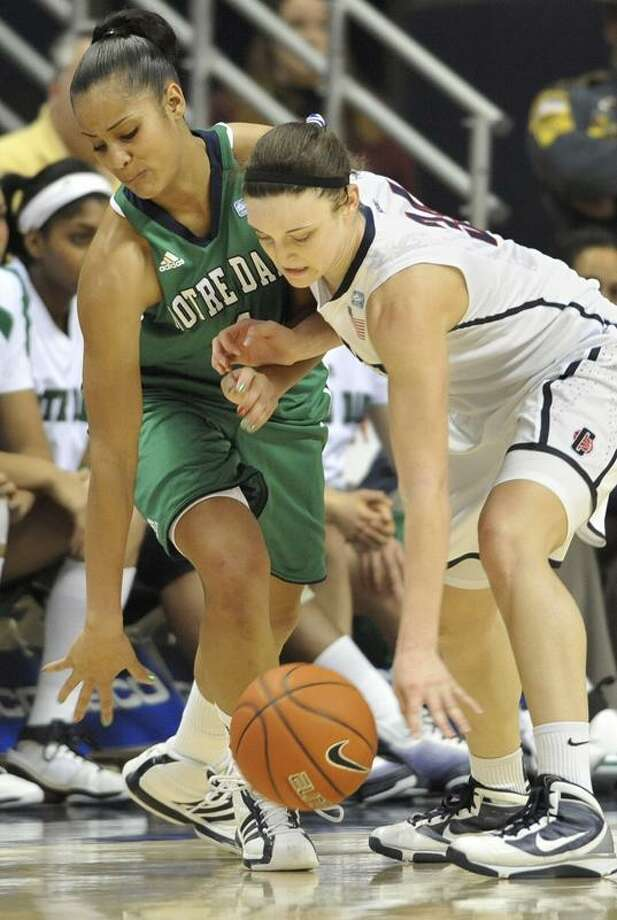 Connecticut's Kelly Faris steals the ball from Notre Dame's Skylar Diggins during the second half of an NCAA college basketball game, in Storrs, Conn., Saturday, Feb. 19, 2011. (AP Photo/Jessica Hill) / AP2011