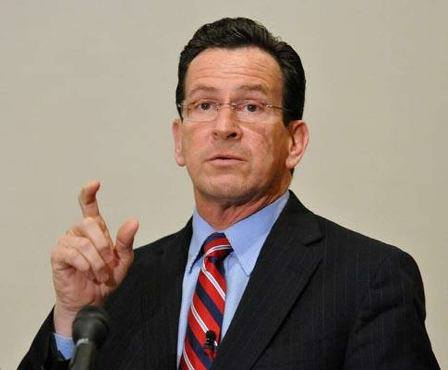 Bridgeport-- Governor Dannel Malloy speaks during a town hall meeting at the city hall annex, the first in a series of 17 such meetings he has planned around the state to talk about the state budget. Photo by Peter Casolino/New Haven Register02/21/11 Cas11021