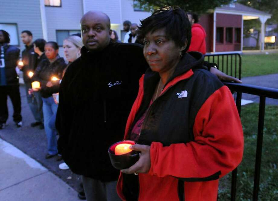 The family and friends of Chauncey Hardy including Chuck Tyler and his wife Theresa Ross Tyler of Middletown gathered near his childhood home in Middletown to call attention to the questions surrounding his death in Romania. Chuck coached Chauncey in AAU, Theresa works with Chauncey's mother Ola. Photo by Mara Lavitt/New Haven Register10/15/11