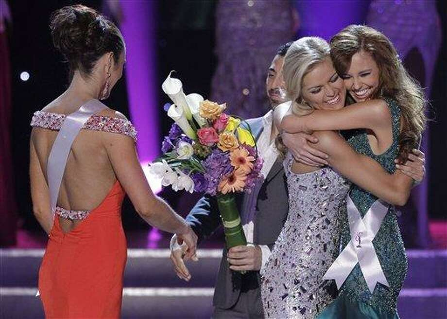Madeline Mitchell, left, Miss Alabama, walks away as Alyssa Campanella, Miss California, right, and Miss Tennessee, Ashley Elizabeth Durham react as they are annouced as the two remaining finalists in the 2011 Miss USA pageantSunday, June 19, 2011, in Las Vegas.  (AP Photo/Julie Jacobson) Photo: ASSOCIATED PRESS / AP2011