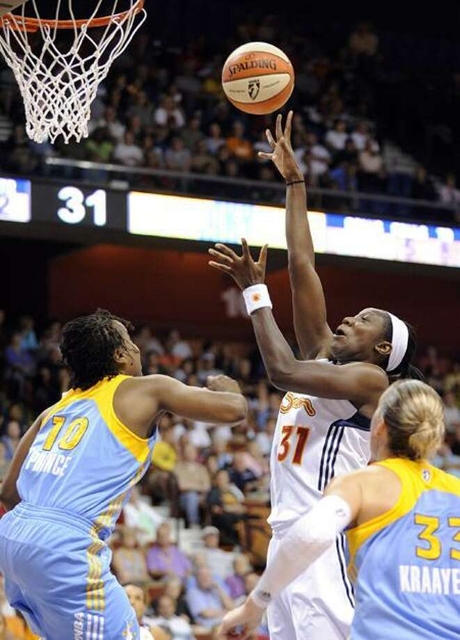 Connecticut Sun's Tina Charles shoots over Chicago Sky's Epiphanny Prince during the first half of their WNBA basketball game in Uncasville, Conn., on Sunday, June 19, 2011. (AP Photo/Fred Beckham) Photo: AP / FR153656 AP