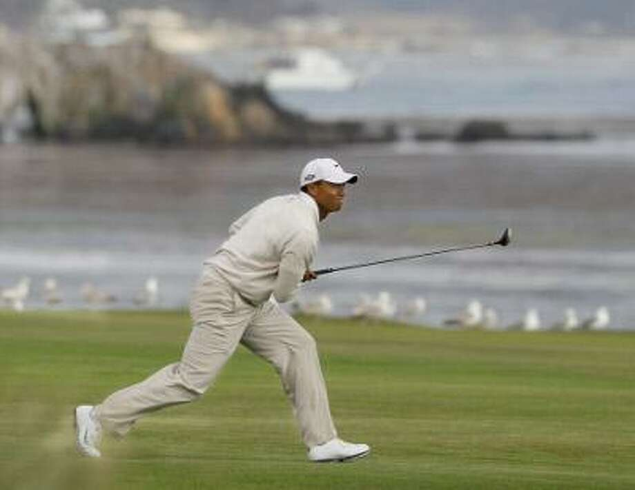Tiger Woods watches his approach shot to the 18th green during the third round of the U.S. Open golf tournament Saturday, June 19, 2010, at the Pebble Beach Golf Links in Pebble Beach, Calif.