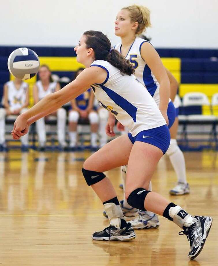 "Special to the Press  10.14.11  MercyÕs Nina Zimitti concentrates on a power serve in FridayÕs volleyball game. Mercy won, 3-0. To buy a glossy print of this photo and more, visit <a href=""http://www.middletownpress.com"">www.middletownpress.com</a>. / a"