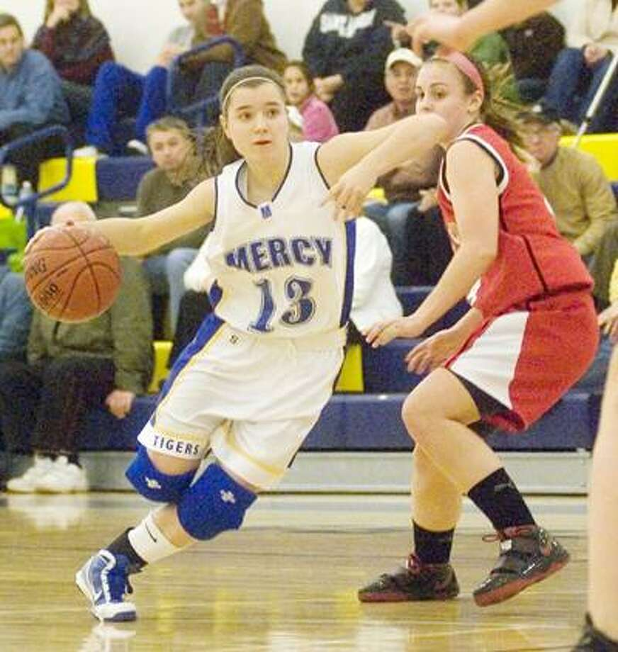 Mercy's Maria Wesleyj drives to the basket Wednesday against Cheshire at Mercy High School. (Max Steinmetz / Special to the Press)