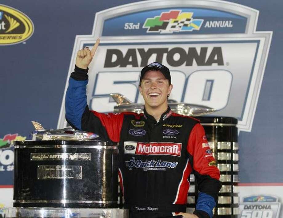 Trevor Bayne poses with the trophy after winning the Daytona 500 NASCAR auto race at Daytona International Speedway in Daytona Beach, Fla., Sunday, Feb. 20, 2011. (AP Photo/Terry Renna) Photo: ASSOCIATED PRESS / AP2011