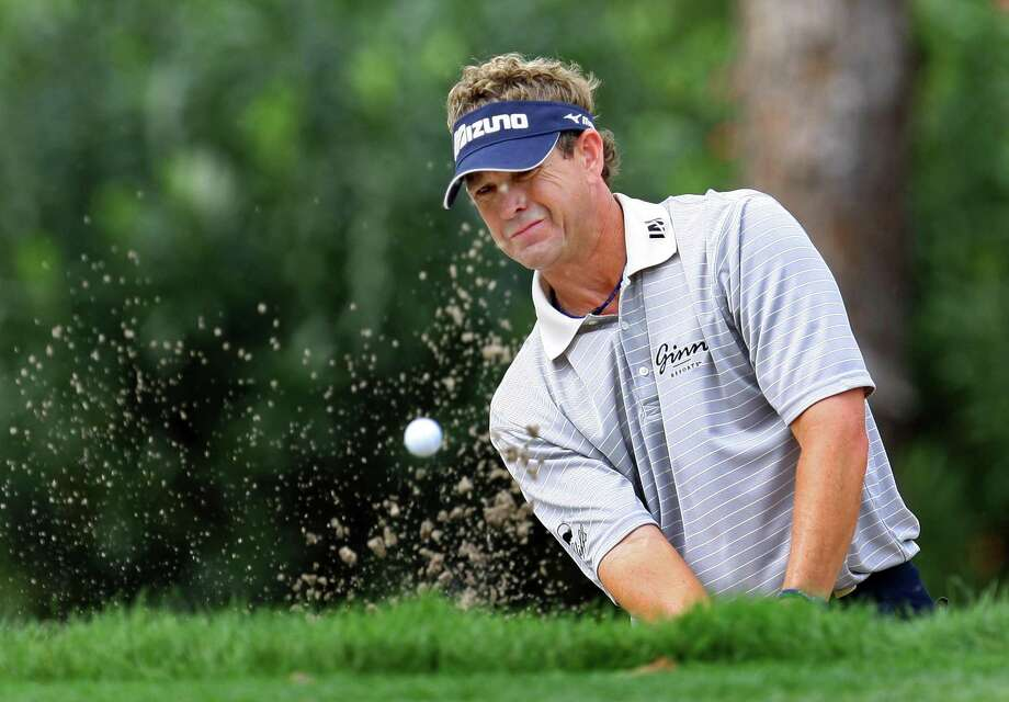 Lee Janzen blasts from the sand trap on the 17th hole during the second round of the PODS Championship golf tournament Friday March 7, 2008 at Innisbrook in Palm Harbor, Fla. (AP Photo/Chris O'Meara) Photo: ASSOCIATED PRESS / AP2008