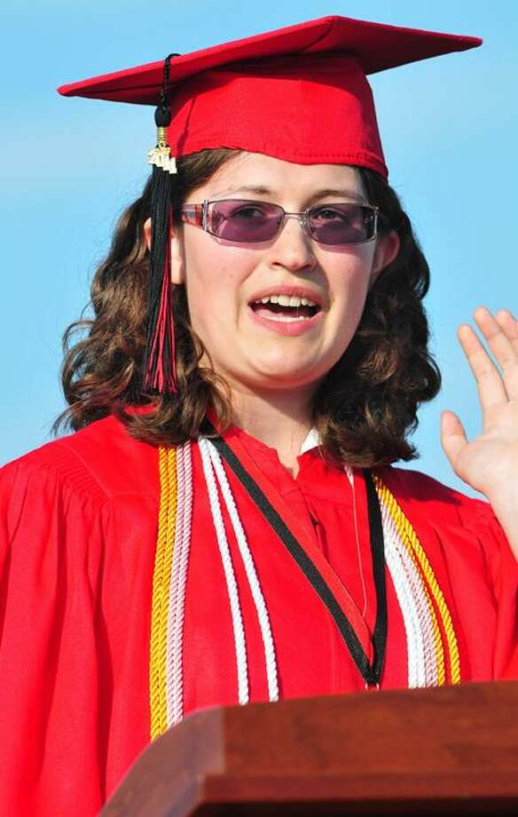 The Middletown Press  6.20.11  A thumbs up from Jeff Realejo during commencement exercises at Portland High School Monday evening. To buy a print of this photo and more, visit www.middletownpress.com / TheMiddletownPress