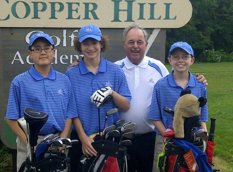 DAN PODHEISER - MIDDLETOWN PRESS - Jason Liu, left, AJ Ouimet, second left, and Chase Skrubis, right, will play in Pro-Am events at The Travelers Championship at TPC River Highlands in Cromwell on Tuesday and Wednesday thanks to The First Tee of Connecticut. Vic Svenberg, second right, is the founder of The First Tee's Suffield branch and mentor to the three boys.