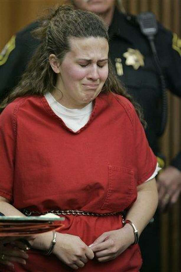 In this April 14, 2009, photo, Melissa Huckaby, 28, is shown in a Stockton, Calif., courtroom during her arraignment. Huckaby has pleaded guilty to killing her daughter's playmate, Sandra Cantu, last year. A gag order has been in place in the case preventing court records from being unsealed. Several news organizations, including The Associated Press, are expected to argue in a Stockton court on May 24, that information on the case be made public. (AP) Photo: AP / AP2009
