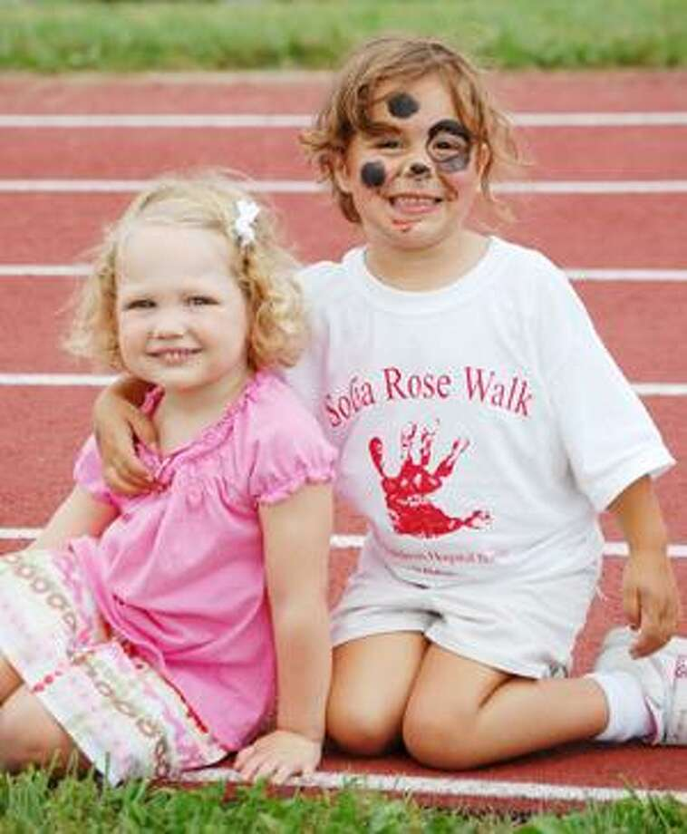 (Contributed photo) Sophia Rose, 3, at right, poses with a friend during a walk-a-thon hosted by her parents last September that raised more than $23,500 for the Sophia Rose Foundation.  After Sophia Rose was diagnosed with a brain tumor, her mother and father, Salvatore and Silvana Salafia Pepitone met several families at Children's Hospital Boston who struggled with the exorbitant costs associated with staying in Boston while their children were being treated. The couple decided to raise money to help defray some of those expenses.