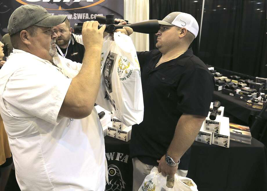 Jordan, left, and Justin Smith of Spring, Texas check out scopes from SWFA during the  Hunter's Extravaganza sponsored by the Texas Trophy Hunters Association at NRG Center on  Saturday, Aug. 13, 2016, in Houston. ( Elizabeth Conley / Houston Chronicle ) Photo: Elizabeth Conley, Staff / Houston Chronicle / © 2016 Houston Chronicle