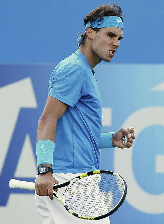Rafael Nadal of Spain reacts after playing a return to Radek Stepanek of Czech Republic during their singles tennis match at the Queen's Grass Court Championship in London, Thursday, June 9, 2011. (AP Photo/Kirsty Wigglesworth) Photo: ASSOCIATED PRESS / AP2011