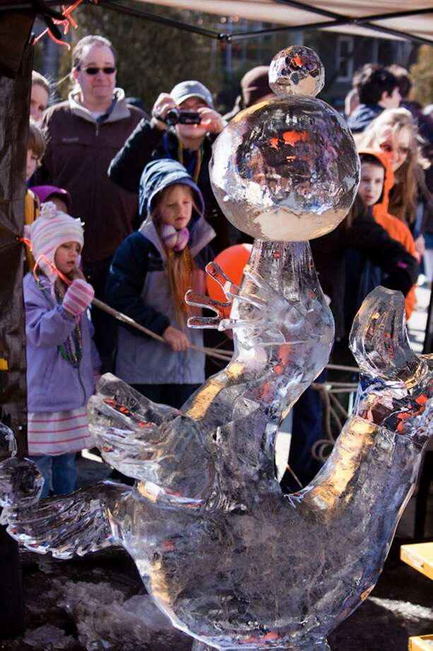 Onlookers admire a carving from the 2010 Chester Winter Carnivale.