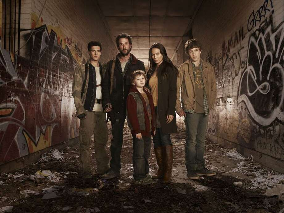 The Falling Skies cast, with (center) Noah Wyle and Moon Bloodgood.(Journal Register News Service) / TM & © Cable News Network. A Time Warner Company. All Rights Reserved.
