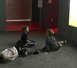 Kids entranced by Ragnar Kjartansson's 'The Visitors' at SFMOMA