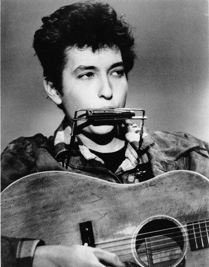 Folk singer and songwriter Bob Dylan plays the harmonica and acoustic guitar in March, 1963 at an unknown location.  He was born in Duluth, Mn., in 1941 as Robert Allen Zimmerman. (AP Photo) Photo: ASSOCIATED PRESS / AP1963