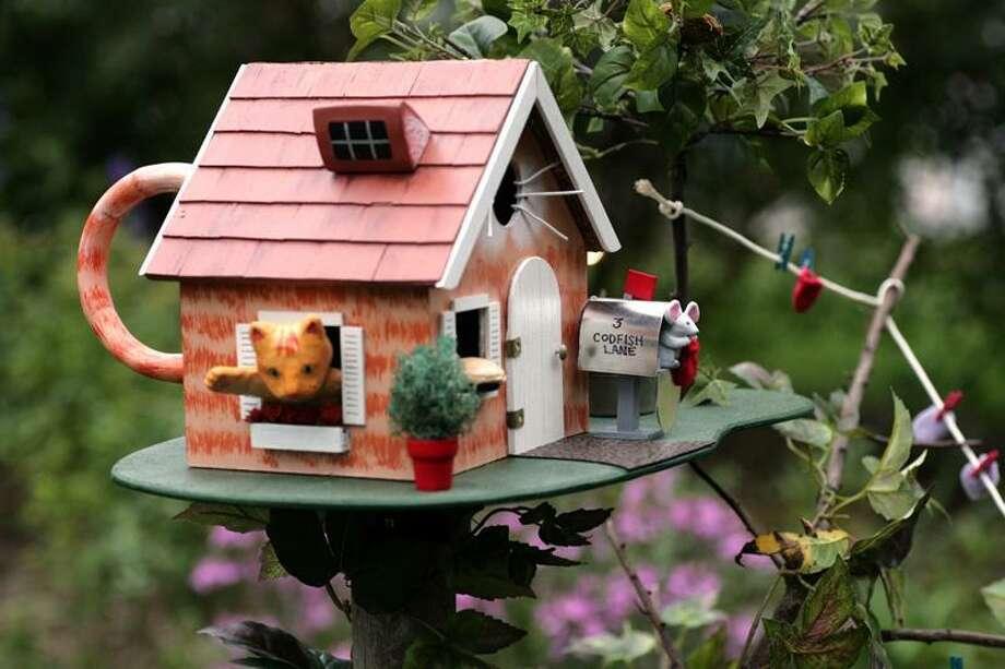 "Sean Flynn: Wallingford artist Cathy DeMeo's ""Three Little Kittens"" birdhouse."