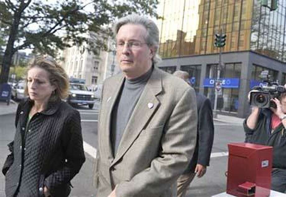 Dr. William Petit Jr. arrives at Superior Court with his sister Johanna Petit Chapman, left, for the first day of the penalty phase of the trial of 47-year-old Steven Hayes in New Haven, Conn., on Monday. Hayes was convicted of 16 counts for the 2007 killings in Cheshire.   (AP Photo/Jessica Hill) Photo: AP / AP2010