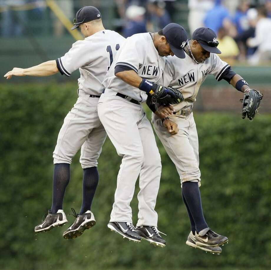New York Yankees' Curtis Granderson, right, Chris Dickerson, center, and Brett Gardner celebrate after the Yankees defeated the Chicago Cubs 4-3 during an interleague baseball game, Saturday, June 18, 2011, in Chicago. (AP Photo/Nam Y. Huh) Photo: ASSOCIATED PRESS / AP2011