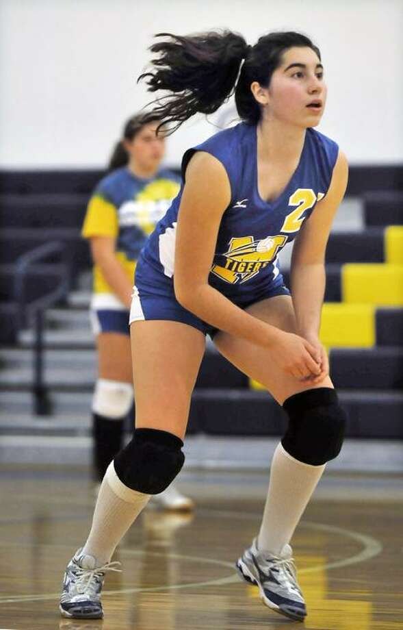 Mercy's Erin Fitzgerald prepares for a set against Hamden Wednesday evening. (Catherine Avalone / TheMiddletownPress