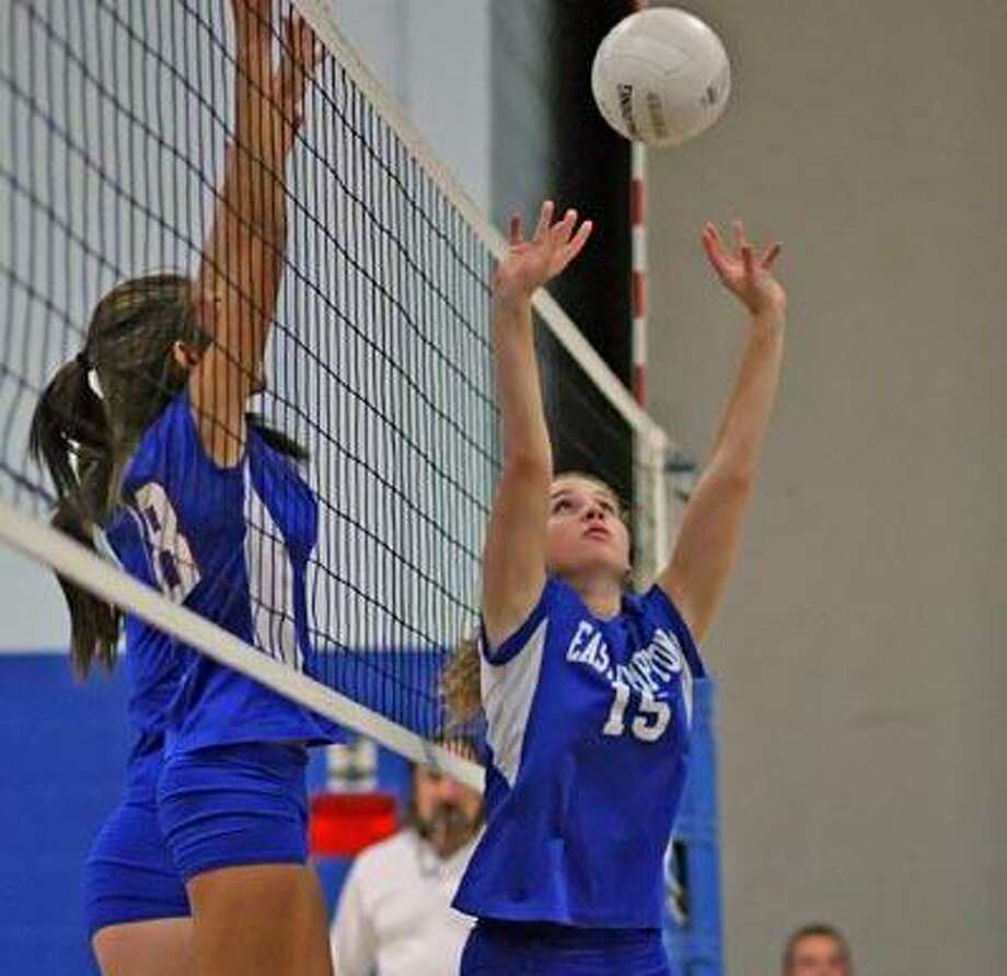 East Hampton's Marissa Morassini sets as Hale Ray's Angela Hall goes up for a block Wednesday. (Todd Kalif