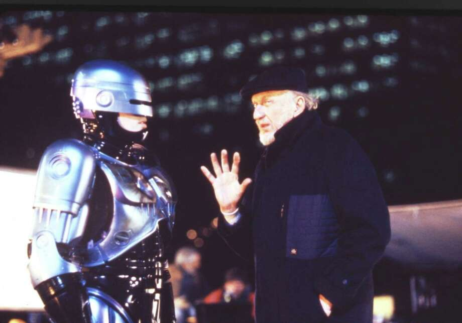 "This 1990 file photo released by Orion Pictures Corp. shows film director Irvin Kershner, right, and actor Peter Weller, portraying Robocop, during the making of ""Robocop II."" A group working to build a statue in Detroit of the fictional crime-fighting cyborg RoboCop says it has reached its fundraising goal of $50,000. Brandon Walley of Imagination Station said Wednesday, he's ""very positive"" the sculpture will become a reality. (AP Photo/Orion Pictures Corp., Deana Newcomb, File) Photo: AP / AP2010"