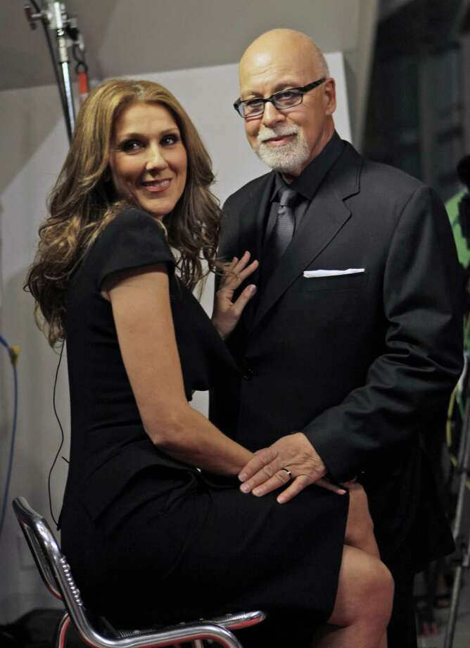 "FILE - In this Feb. 16, 2010 file photo, Celine Dion, left, poses with her husband Rene Angelil, as they arrive for the premiere of the film ""Celine: Through the Eyes of the World"" in Miami Beach, Fla. Dion has been admitted to a Florida hospital to prevent the early delivery of her twins. The singer is at St. Mary's Medical Center in West Palm Beach, Fla. The hospital said in a statement the admission was recommended to make sure she's near her doctors leading up to the babies' birth.  (AP Photo/Lynne Sladky, file) Photo: AP / AP2010"