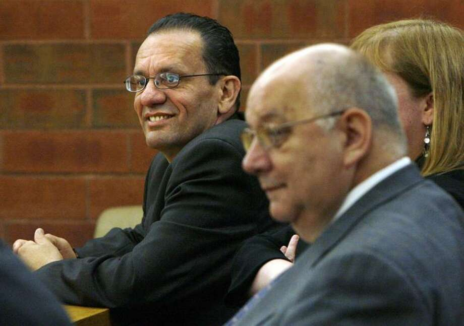 Hartford Mayor Eddie Perez, left, is shown in Hartford Superior Court today on the second day of jury deliberations in his corruption trial in Hartford. A Connecticut jury has convicted Perez of corruption charges, including accepting home improvements as a bribe and trying to extort money from a real estate developer. (AP) Photo: AP / The Hartford Courant, Pool