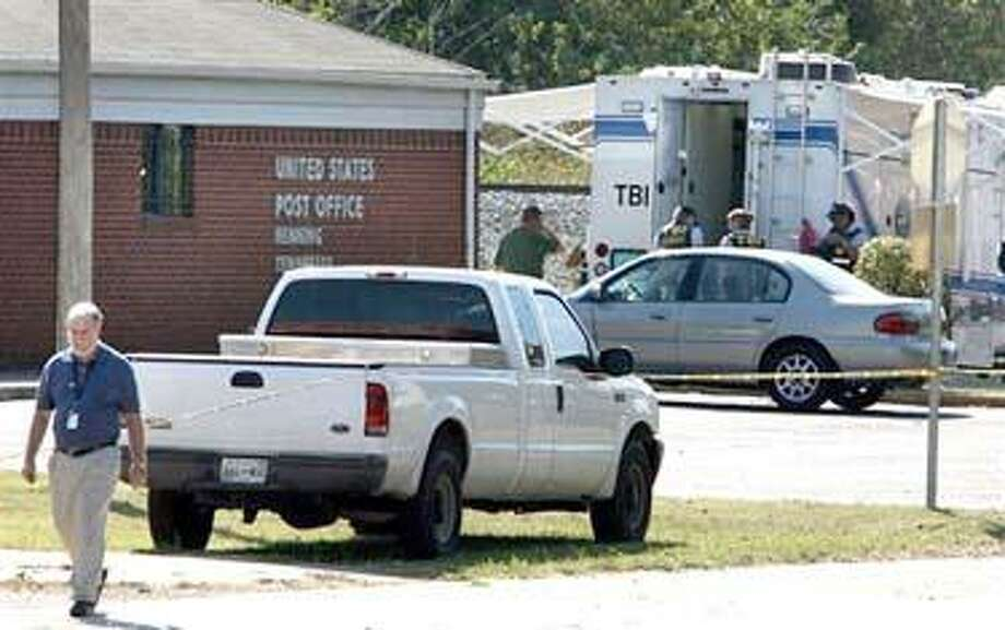 Investigators are on the scene of a double murder at the U.S. Post Office in Henning, Tenn. Monday, Oct. 18, 2010. Two women were shot and killed Monday during a possible robbery attempt, authorities said. (AP Photo/ The Commercial Appeal, Dave Darnell) NO SALES, MAGS OUT, TV OUT, MEMPHIS OUT, ON LINE OUT Photo: AP / The Commercial Appeal