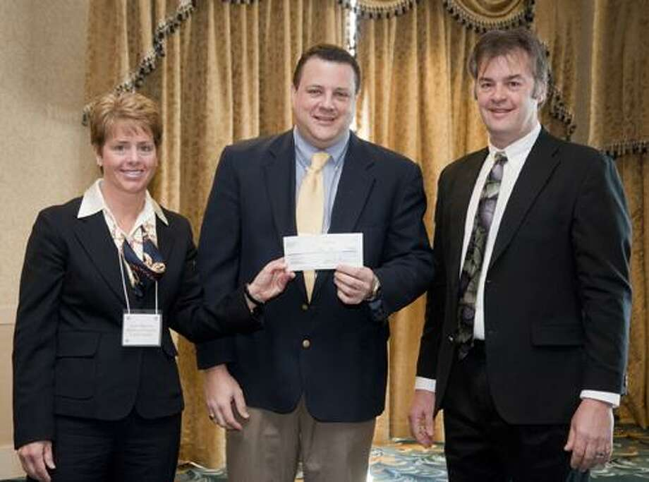 Laura Martino, Director of Marketing and Gary Havican, administrative director of Middlesex Hospital Cancer Center received a donation in the amount of $19,688 from John Dolishny, general manager of Tanger Outlets in Westbrook. The presentation took place at Water's Edge Resort and Spa in Westbrook on Tuesday during the Tanger Outlets annual mangers meeting.