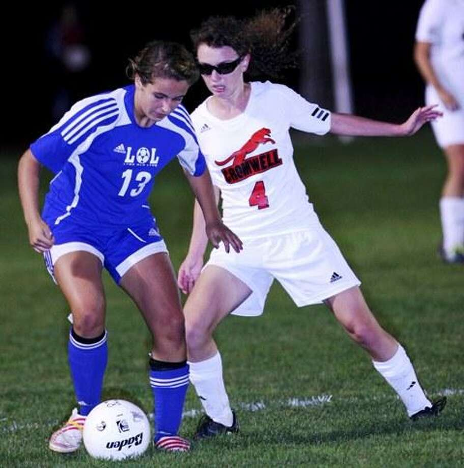 "Special to the Press  10.11.11  Cromwell's Bridget Delisle battles Old Lyme's Olivia Borsari in Cromwell's soccer game against Old Lyme on Tuesday. Cromwell won, 4-1. To buy a glossy print of this photo and more, visit <a href=""http://www.middletownpress.com"">www.middletownpress.com</a>."