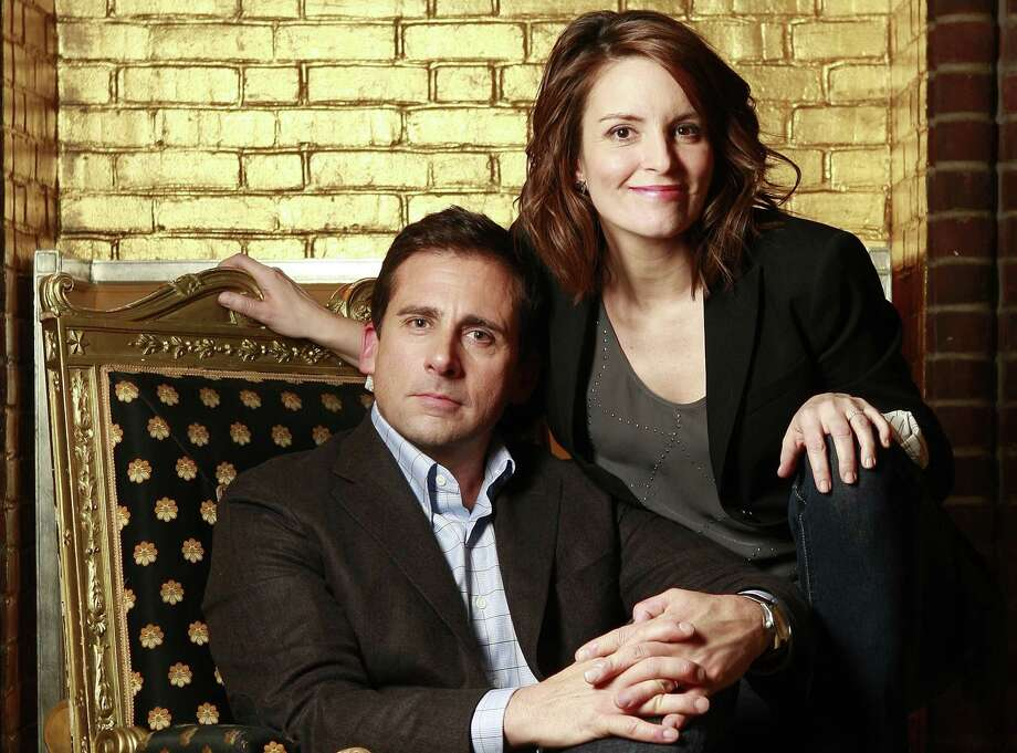 "In this Feb. 18, 2010, file photo, actors Steve Carell, left, and Tina Fey pose for a portrait at the Hudson hotel in New York while promoting the film ""Date Night."" (AP) Photo: AP / AP2010"