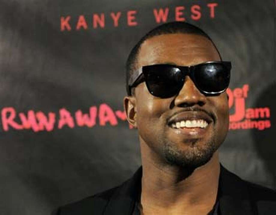 "Hip-hop artist Kanye West arrives for a screening of ""Runaway,"" a short film He directed that will accompany his forthcoming album ""My Beautiful Dark Twisted Fantasy,"" Monday, Oct. 18, 2010, in Los Angeles. (AP Photo/Chris Pizzello) Photo: AP / AP"