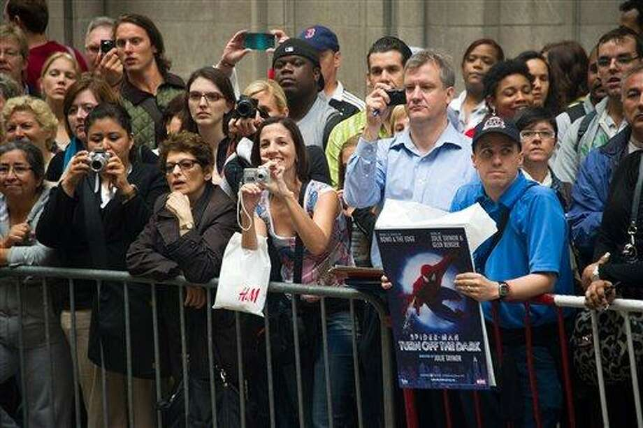 """Fans watch the arrivals at the opening night performance of the Broadway musical """"Spider-Man: Turn Off the Dark"""" in New York, Tuesday. (AP Photo/Charles Sykes) Photo: ASSOCIATED PRESS / AP2011"""