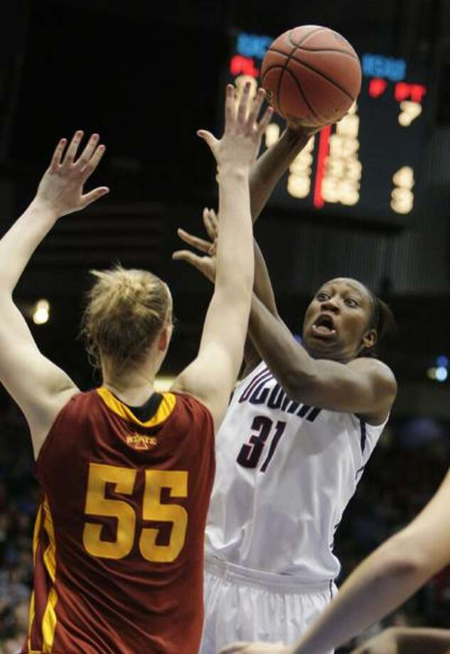Connecticut's Tina Charles (31) shoots over Iowa State's Anna Prins (55) in the first half of an NCAA Dayton Regional semifinal college basketball game Sunday, March 28. (Associated Press) Photo: AP / AP