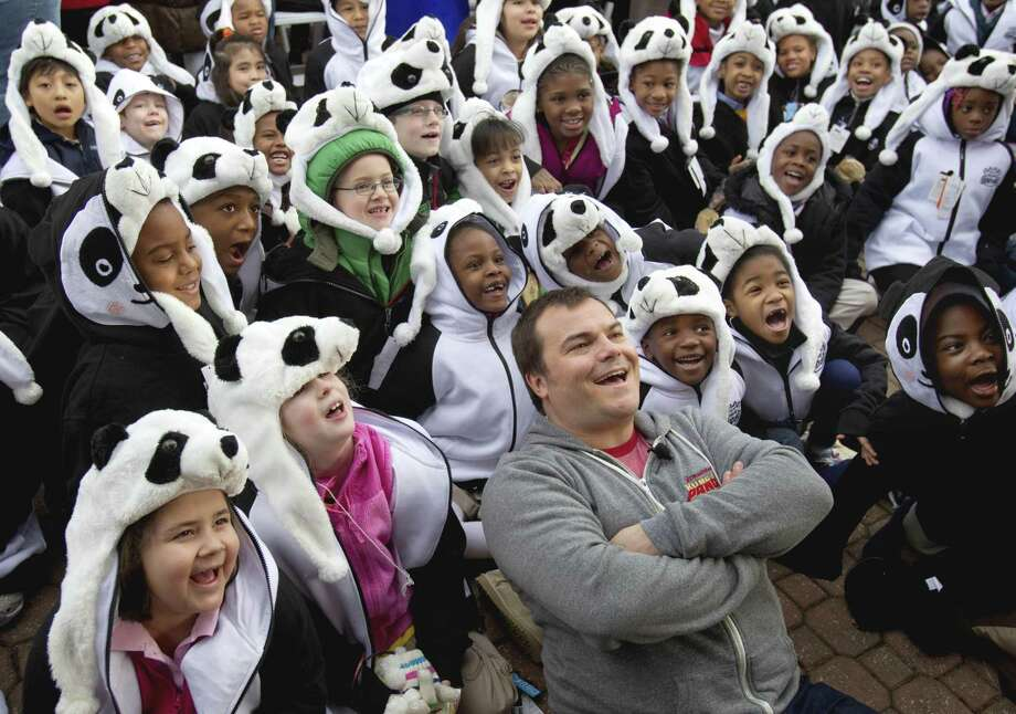 "Actor Jack Black, center front, poses for pictures with students from Parkside Elementary and Kipp Elementary schools in Atlanta, during a naming ceremony for a 3-month-old giant panda cub born at the Atlanta Zoo Tuesday, in Atlanta. Black who is promoting his animated film, ""Kung Fu Panda II"", posed for pictures with the cub, who is the only giant panda born at a U.S. zoo last year. (AP Photo/David Goldman) Photo: ASSOCIATED PRESS / AP2011"
