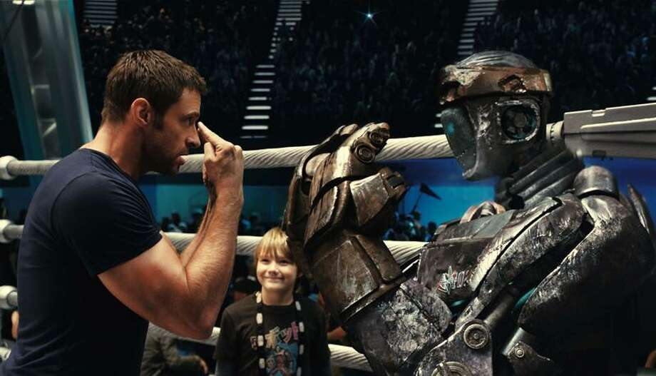 "Hugh Jackman, left, and Dakota Goyo in a scene from ""Real Steel."""
