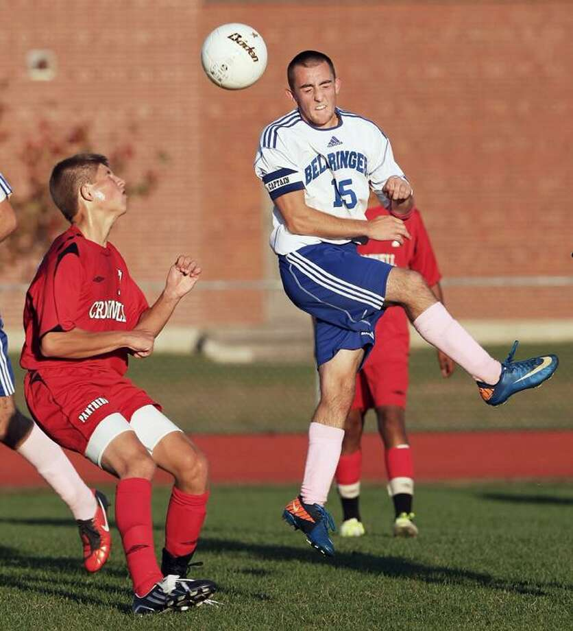 """Special to the Press  10.10.11  CromwellÕs Michael McNally and East HamptonÕs Benjamin Boscarino fight for position in MondayÕs boys soccer game between Cromwell and East Hampton. East Hampton won, 2-1. To buy a glossy print of this photo and more, visit <a href=""""http://www.middletownpress.com"""">www.middletownpress.com</a>. / a"""