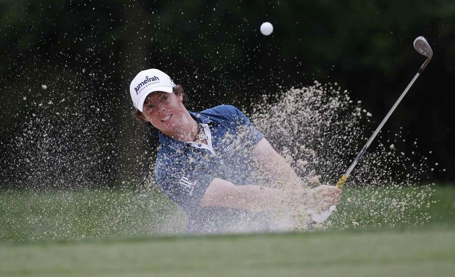 Rory McIlroy, of Northern Ireland, chips out of a bunker to the 14th green during the first round of the U.S. Open Championship golf tournament in Bethesda, Md., Thursday, June 16, 2011. (AP Photo/Matt Slocum) Photo: ASSOCIATED PRESS / AP2011